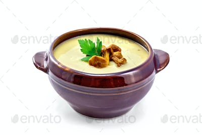 Soup-puree mushroom in clay bowl