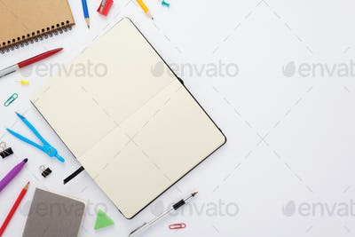 paper notebook and school supplies at white