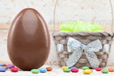 Chocolate Easter holiday egg on rustic backround