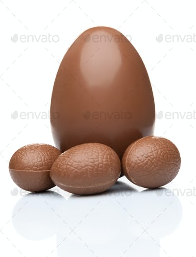 Chocolate Easter eggs and sweets on white background