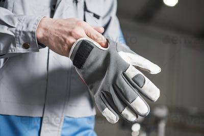 Worker Wearing Gloves