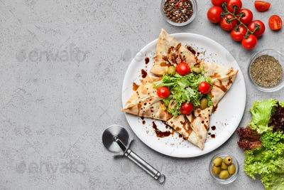Star shaped pizza decorated with lettuce and tomatoes