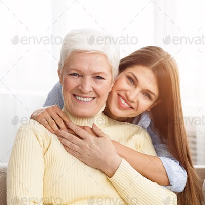 Young daughter embracing her mother with love