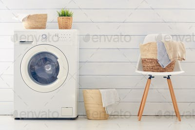 laundry room with a washing machine