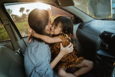 mother and kid enjoy trip in the car