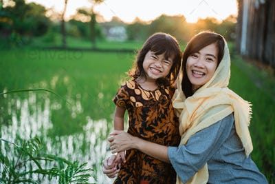muslim asian woman outdoor with her daughter