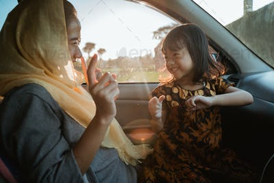 muslim mother and daughter on road trip