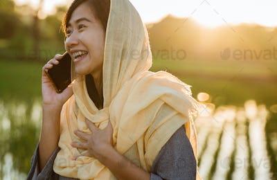 asian woman talking on phone