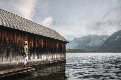 Young woman with a backpack on a pier