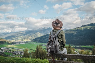 Young woman with a backpack outdoors