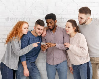 Man showing video on phone to friends