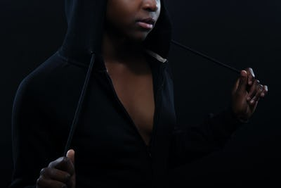 Cropped portrait of a woman with dark skin and attitude wearing hoodie