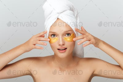 Portrait of young pretty lady with white towel on head without m