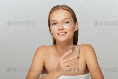 Portrait of beautiful smiling lady without makeup with transpare