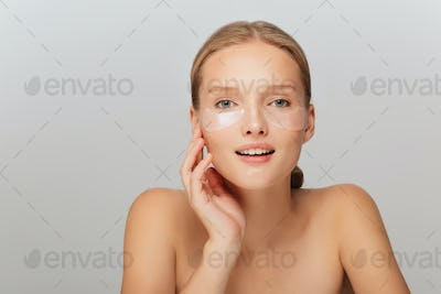 Portrait of attractive girl without makeup with transparent patc