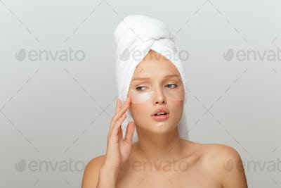 Portrait of young upset lady with white towel on head without ma