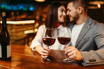 Romantic evening, couple in bar, date celebration