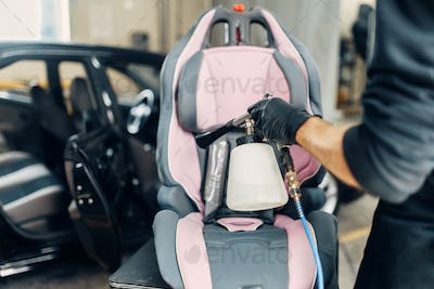 Carwash, removing of dust and dirt from child seat