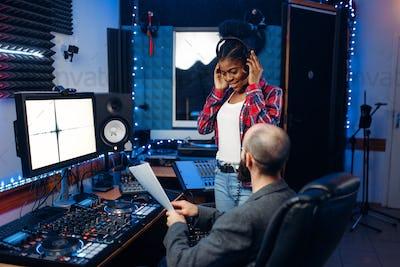 Sound operator and female singer, recording studio