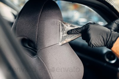 Dry cleaning of car seats with vacuum cleaner
