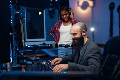 Sound engineer and female singer, recording studio