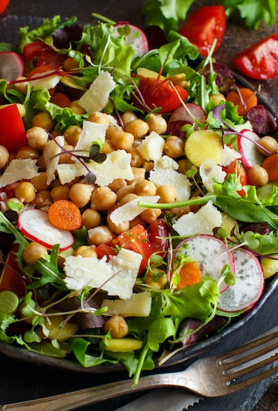 Chickpea salad with vegetables and microgreens