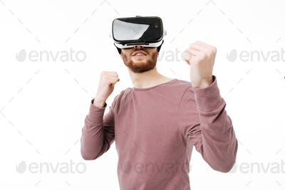 Portrait of cool boy in fighter stand playing in visual reality glasses isolated