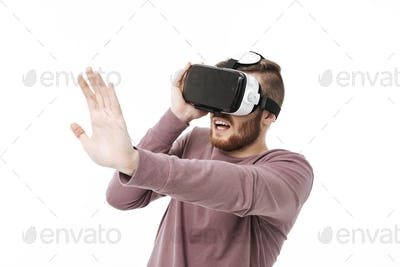 Cool boy playing with visual reality glasses and showing stop gesture isolated