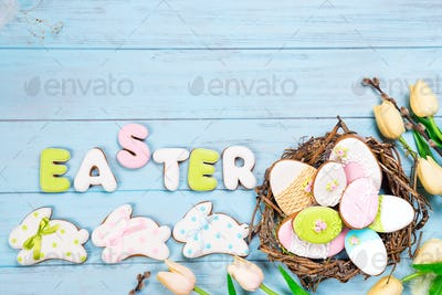 Delicious Easter cookies background. Eggs with different pattern icing on blue wooden background