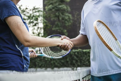 Tennis players shaking hands after a good match