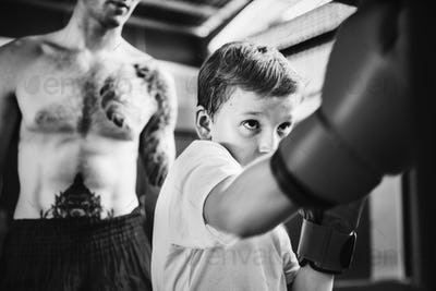 Young boy aspiring to become a boxer