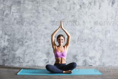 Beautiful woman practicing yoga.