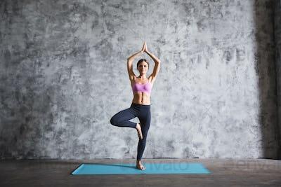 Woman practicing yoga indoors.