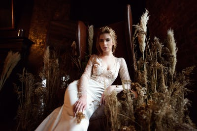 Blonde bride in fashion white wedding dress with makeup