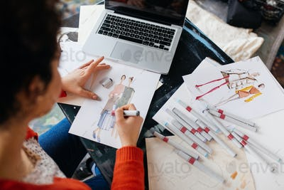 Top view of young woman sitting at the table with laptop dreamil