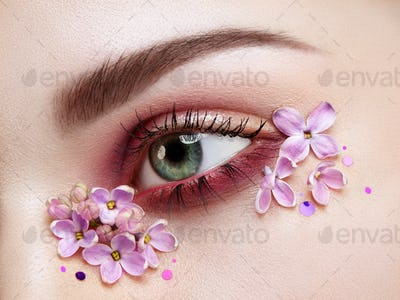 Eye makeup woman with a lilac flowers