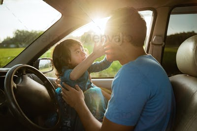 father daughter playing in the car together