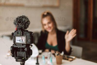 Close up professional black camera recording new video blog isol