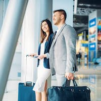 Business class passengers with baggage in airport