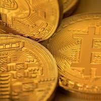 Top view closeup photo of many gold bitcoins