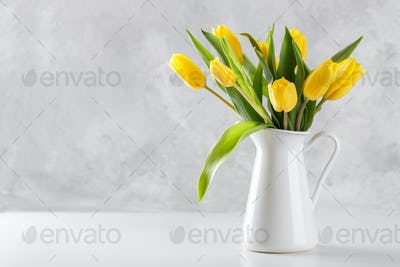 Yellow tulips in a pitcher