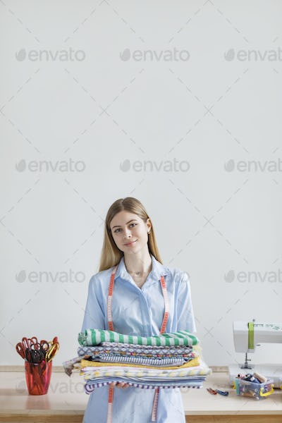 Young beautiful girl in blue shirt happily looking in camera whi