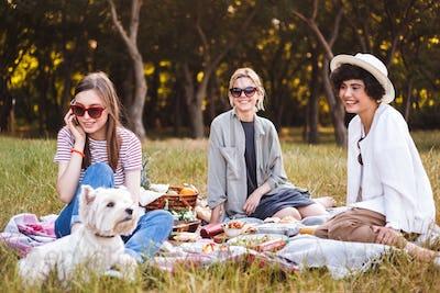 Pretty girl in sunglasses talking on cellphone happily spending