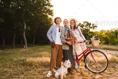 Beautiful girls with bicycle and wood basket in hands joyfully l