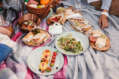 Close up beautiful delicious picnic food and drinks on blanket i