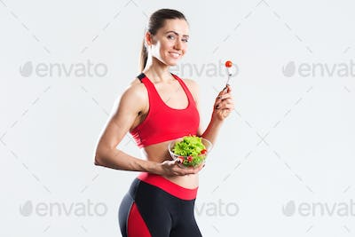 Happy sports woman with salad Isolated.