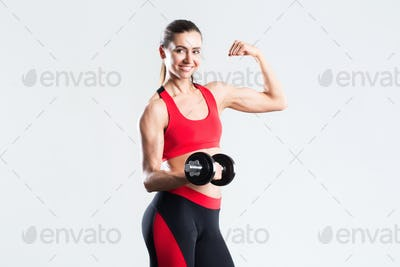Beautiful woman with dumbbells doing exercises isolated.