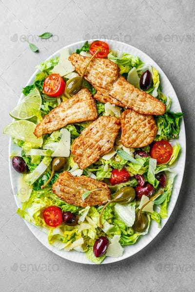 Chicken salad with vegetables and olives