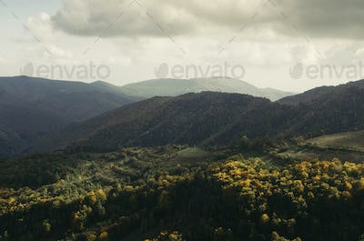 Panoramic view of hills and mountains in natural autumn landscape