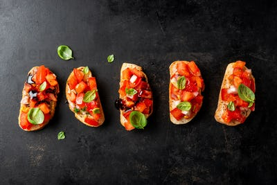 Classic italian bruschetta served on dark board